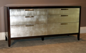 Walnut dresser with silver leaf drawers